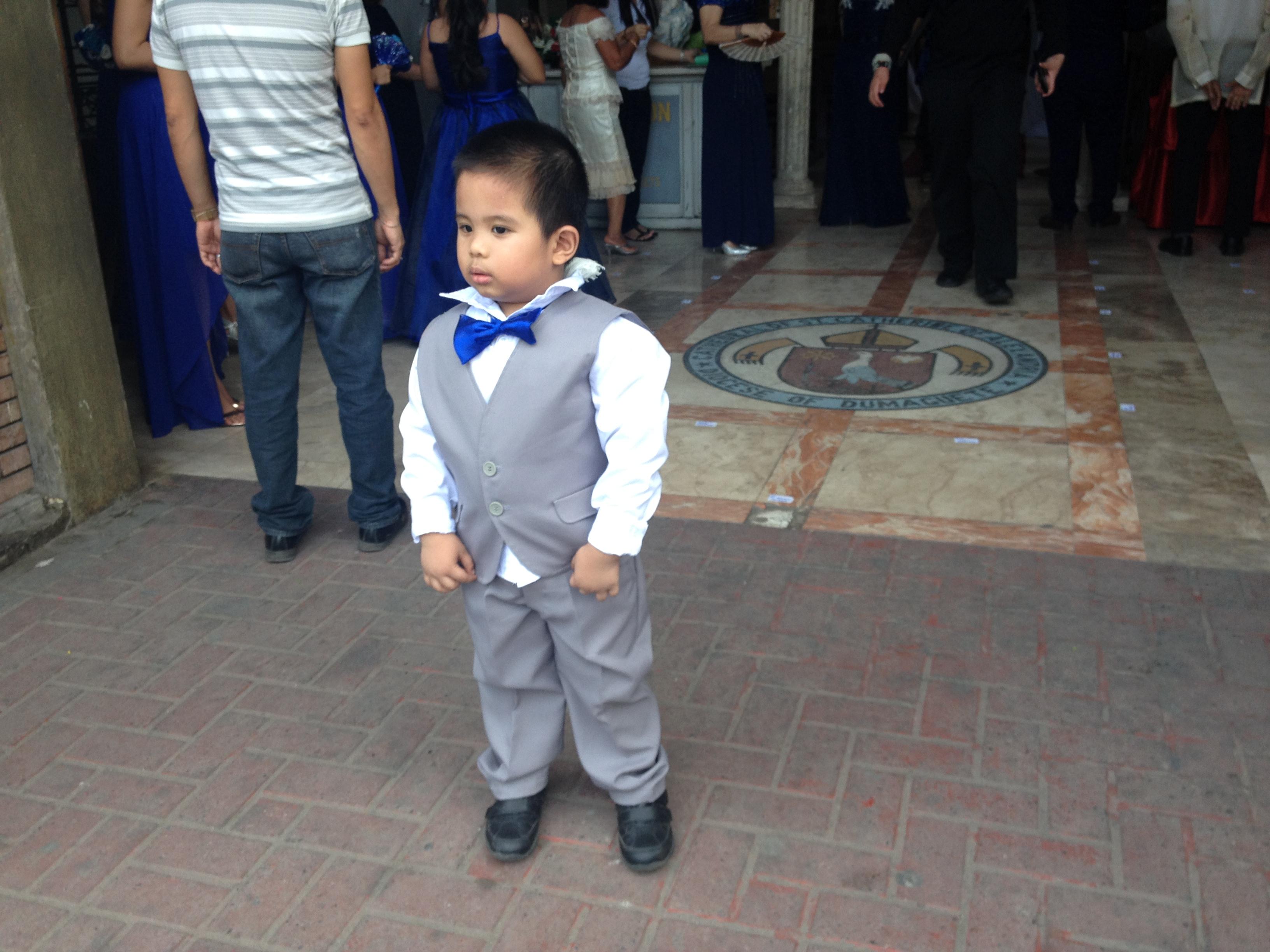 Un bambino filippino in occasione di un matrimonio.